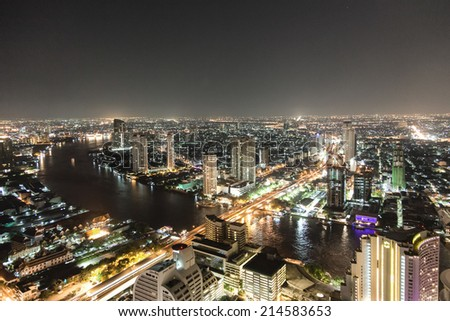 Bankok skyline by night highway and river traffic - stock photo