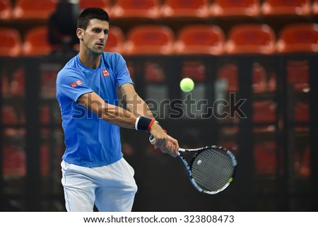 BANKOK THAILAND OCTOBER 01:Serbia's Novak Djokovic hits a return the ball during a training session ahead of their exhibition tennis match at the Hua Mark indoor stadium  on Oct 1, 2015 in Thailand.  - stock photo