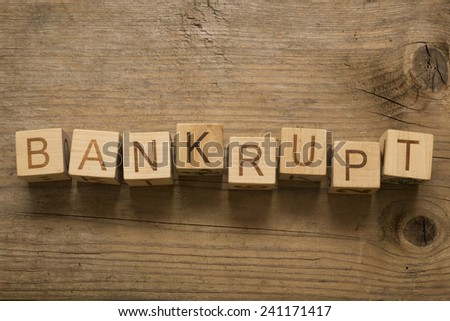bankrupt text on a wooden blocks on a wooden background - stock photo