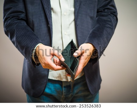 Bankruptcy - Business Person holding an empty wallet - stock photo