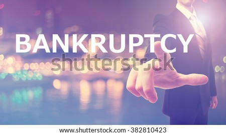 Bankruptcy concept with businessman on blurred city background - stock photo