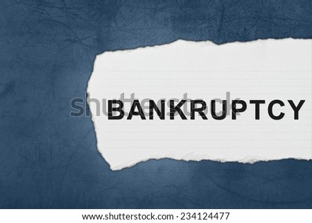 bankruptcy with white paper tears on blue texture - stock photo