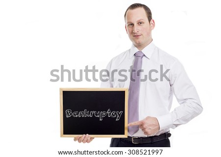 Bankruptcy - Young businessman with blackboard - isolated on white - stock photo