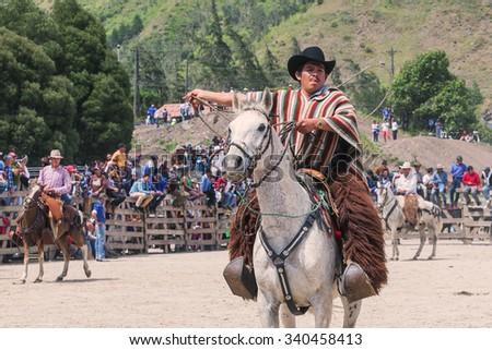 Banos, Ecuador - 30 November 2014: Young Latin Cowboy Is Riding A Horse, Public Demonstration In South America In Banos On November 30, 2014 - stock photo