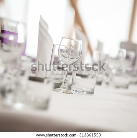 Banquet table. Close-up of empty glasses. Selective focus - stock photo