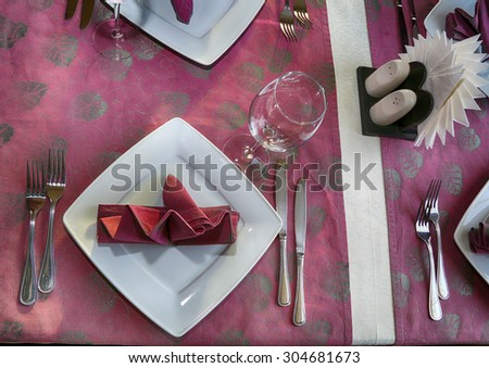 banquet table, cutlery, plates, china, napkins. celebration, fragment