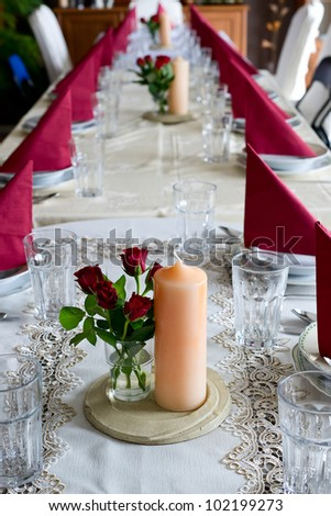 Banquet table setting themed with roses - stock photo