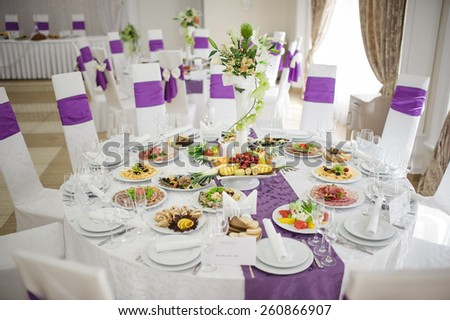 Banquet wedding table setting on evening reception - stock photo