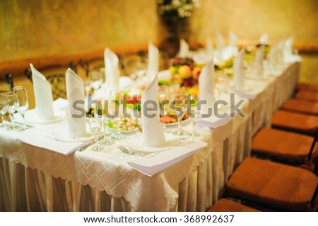 Banquet wedding table setting on evening reception awaiting guests - stock photo