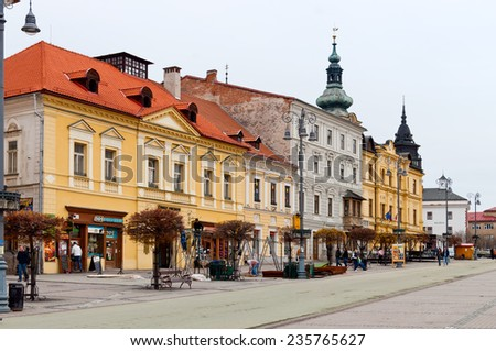 BANSKA BYSTRICA, SLOVAKIA - APR 17: Colorful renovated buildings on Apr 17, 2012 on the main square in Banska Bystrica, the largest city in central Slovakia. - stock photo