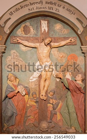BANSKA STIAVNICA, SLOVAKIA - FEBRUARY 5, 2015: The carved relief of Crucifixion as the part of baroque Calvary from years 1744 - 1751. - stock photo