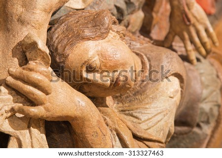 BANSKA STIAVNICA, SLOVAKIA - FEBRUARY 5, 2015: The detail of carved statue of Pieta (Mary of Magdala) as the part of baroque Calvary from years 1744 - 1751 by Dionyz Stanetti. - stock photo