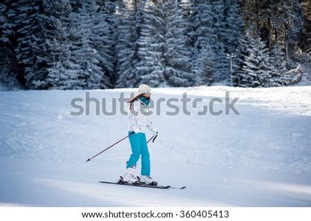 BANSKO, BULGARIA - JANUARY 1, 2016:  woman skiing  at ski resort - stock photo