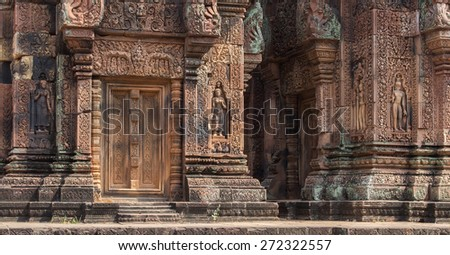 Banteay Srei temple in Cambodia is on the outer part of the Angkor Wat Historic Ruins complex. Tourists and travelers can enjoy these beautiful Buddhist temple ruins. - stock photo