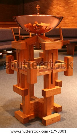 Baptismal font in a lutheran church - stock photo