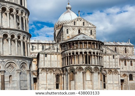 Baptistery, Cathedral and the Pisa Leaning tower in the famous Pisa's Cathedral Square, Square of Miracles (Piazza dei Miracoli), Italy - stock photo