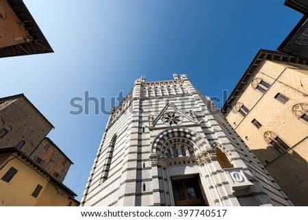 Baptistery of Pistoia - Tuscany Italy / Baptistery of San Giovanni in corte or Ritondo (1303-1361) in Cathedral square (Piazza Duomo). Pistoia, Tuscany, Italy - stock photo