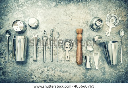 Bar accessories and utensils for making cocktail. Shaker, jigger, strainer, spoon. Vintage style toned picture - stock photo