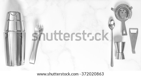 Bar accessories for cocktail making. Shaker, jigger, strainer, tongs, spoon - stock photo