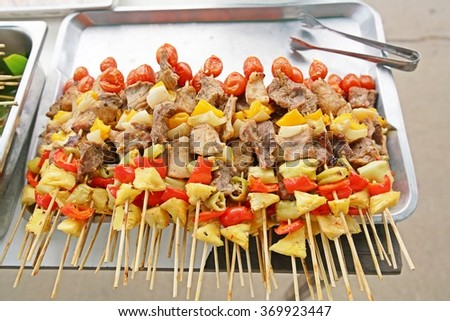 Bar-B-Q or BBQ with kebab cooking. coal grill of chicken meat skewers with peppers on tray.- barbecuing dinner - stock photo