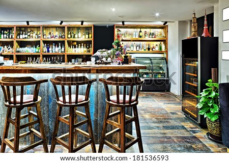 bar counter with chairs in empty comfortable restaurant  - stock photo