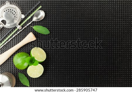 Bar drink accessories over black rubber mat. Top view with copy space - stock photo