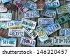 BAR HARBOR, MAINE - JULY 6: Old car license plates on the wall in Bar Harbor on July 6, 2013. In the U.S., where each state issues plates, New York State has required plates since 1901 - stock photo