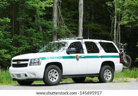 BAR HARBOR, MAINE - JULY 6: US Park ranger car in Arcadia National Park in Bar Harbor on July 6, 2013. National Park Service Rangers are the uniformed employees  protecting the National Park System - stock photo