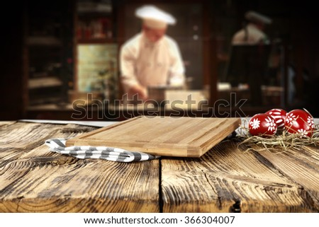 bar interior with chef of kitchen and shabby table place  - stock photo