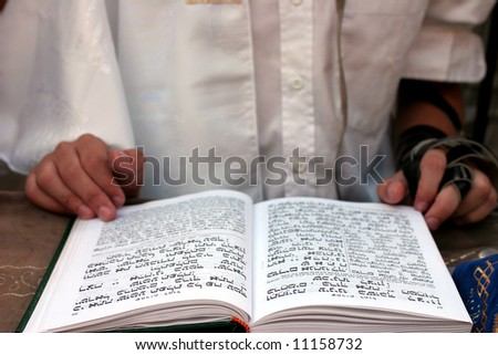 Bar Mitzvah celebrations, ceremonial reading from the Jewish religious book called Torah. - stock photo