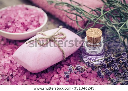 Bar of homemade soaps, sea salt, essential oil and dry lavender flowers. Selective focus. - stock photo