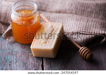 Bar of natural handmade soap with honey on wooden background in rustic style. Selective focus. - stock photo