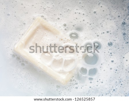 bar of soap with bubbles - stock photo
