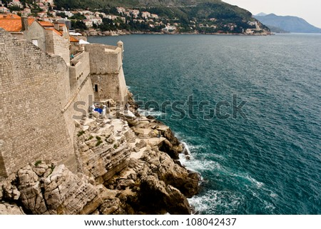 Bar perched on the edge of the sea in Dubrovnik - stock photo