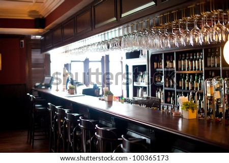Bar with stools and drinks - stock photo
