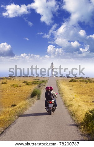 Barbaria cape formentera lighthouse road tourist couple in bike - stock photo