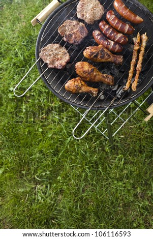 Barbecue a hot summer evening, Grilling - stock photo