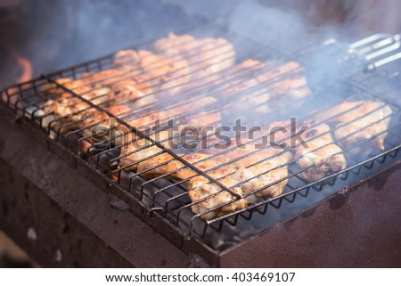 Barbecue. B-B-Q. Grille chicken meat on the grill. Summer rest. A man preparing chicken meat on the grill - stock photo