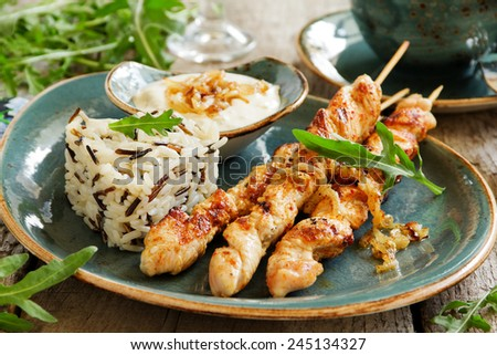 Barbecue beef skewers with sauce. - stock photo