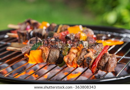 Barbecue grill with various kinds of meat, close-up. - stock photo