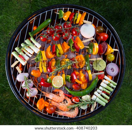 Barbecue grill with various kinds of vegetable, close-up. - stock photo