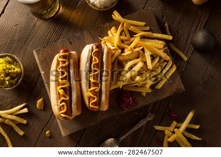 Barbecue Grilled Hot Dog with Yellow Mustard - stock photo