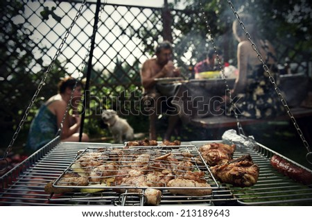 Barbecue in the garden - stock photo