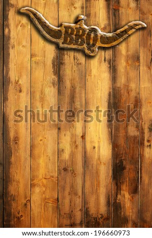 barbecue insignia with horns on a wooden wall - stock photo
