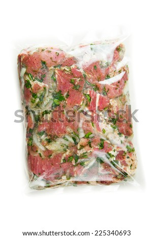 barbecue meat in vacuum marinade bag - stock photo