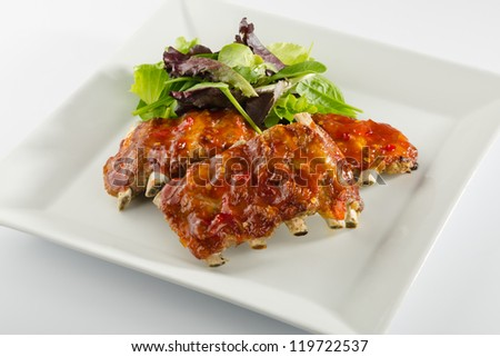 barbecue pork ribs with salad - stock photo