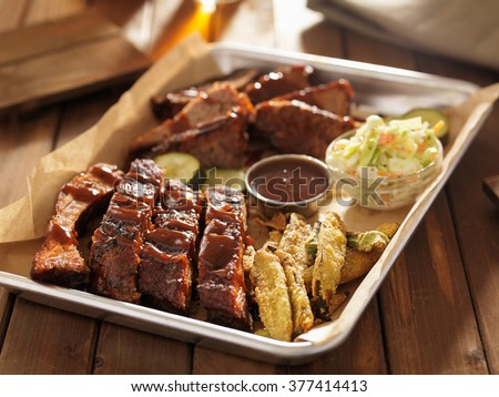 barbecue ribs with brisket, fried okra and slaw - stock photo