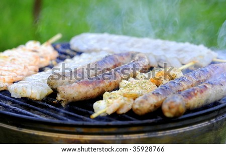 barbecue with sausage and Scampi - stock photo