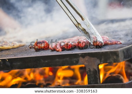 barbecue with sausages and lamb in a medieval fair, Spain - stock photo