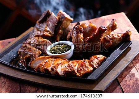 barbecued pieces of meat on a hot pan - stock photo